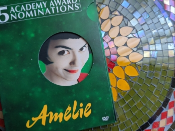 DVD cover of Amelie on a glass mosaic background
